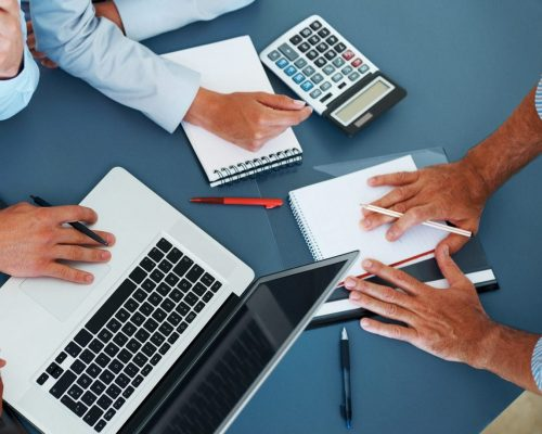 Cropped image of group of businesspeople working together in office - Consulting